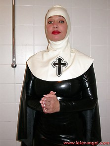 Latex Nun Uses Objects For Pussy Fun