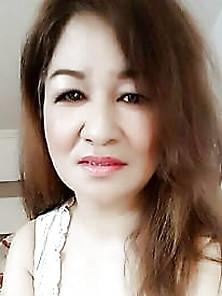 Busty Asian Mature Milf